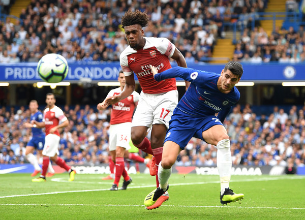 Alex Iwobi of Arsenal battles for possession with Alvaro Morata of Chelsea during the Premier League match between Chelsea FC and Arsenal FC at Stamford Bridge on August 18, 2018 in London, United Kingdom.