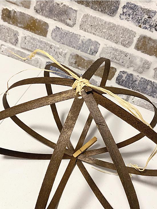 pumpkin shape with raffia and clothespins