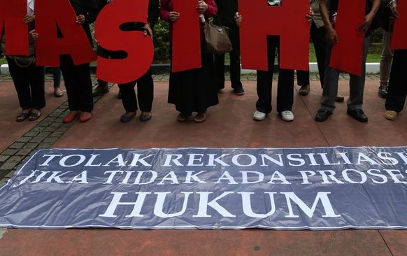 """Jokowi Susun Perpres HAM, KontraS Duga Jadi Ajang """"Cuci Tangan"""""""