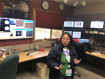 Dr. Karen Kinemuchi, AAVSO and NMSU, explains the 3.5 meter telescope control room (Source: Palmia Observatory)