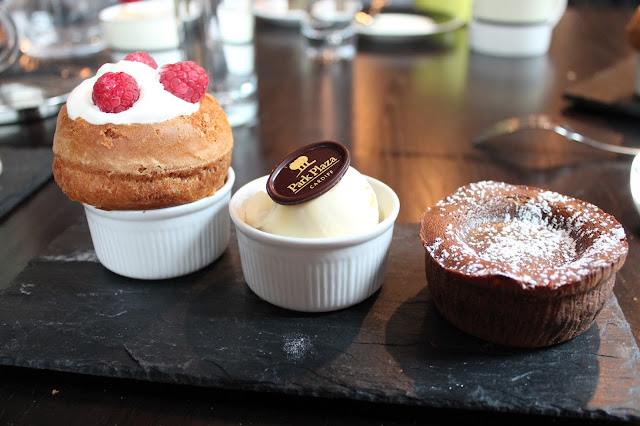 Warm chocolate fondant with clotted cream, rum baba filled with Chantilly cream & raspberries at park plaza afternoon tea