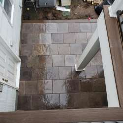 Once the DekTek concrete decking tiles have sealer, their colors really pop