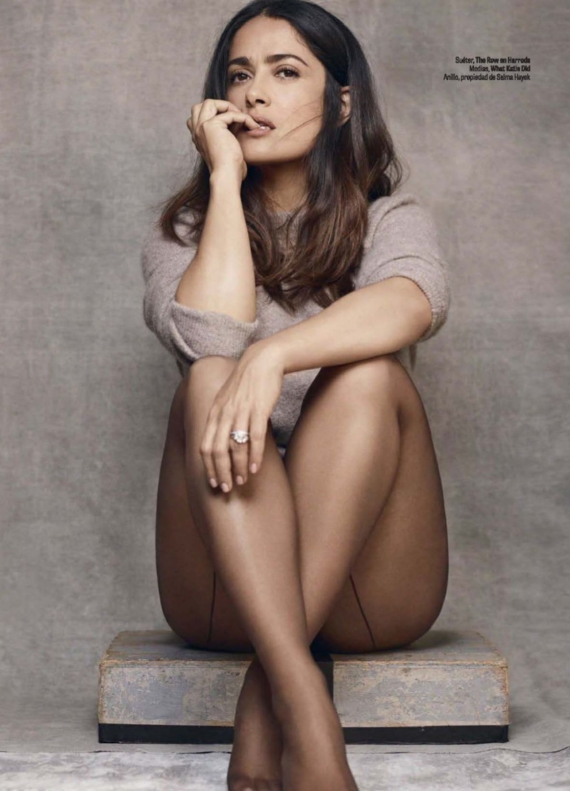 Salma Hayek poses in The Row sweater and What Katie Did hosiery
