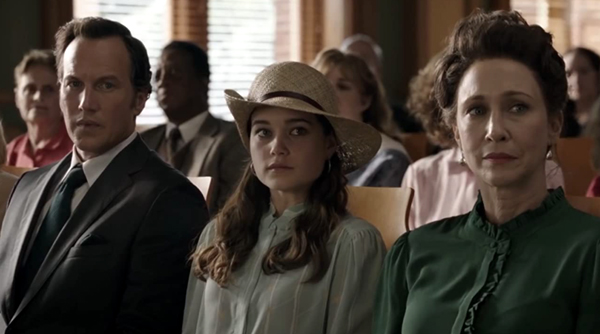 With the Warrens sitting next to her inside a courtroom, Debbie Glatzel (Sarah Catherine Hook) awaits the verdict in Arne Johnson's murder trial...in THE CONJURING: THE DEVIL MADE ME DO IT.