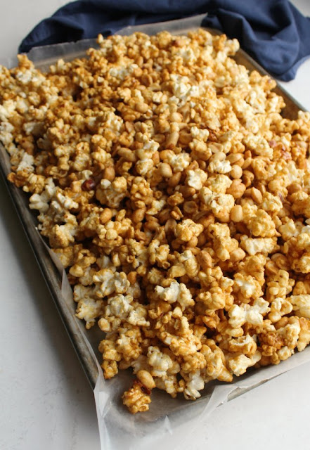 wax paper lined pan filled with cooling caramel corn