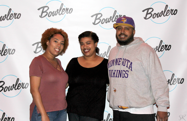 A family at Bowlero grand opening event