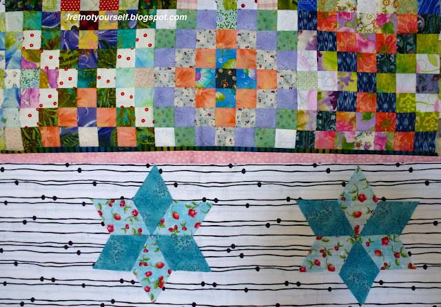 Auditioning six-pointed stars for a quilt border