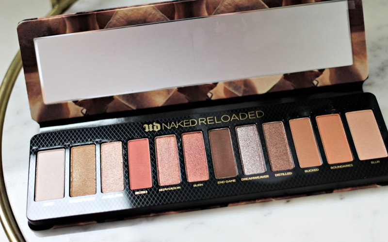 the Naked Reloaded palette opened on a white marble serving tray
