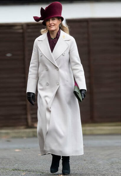 The Countess wore a wool coat from MaxMara, gem drop earrings from Heavenly Necklaces, green skirt and burgundy blouse. Sophie Habsburg clutch