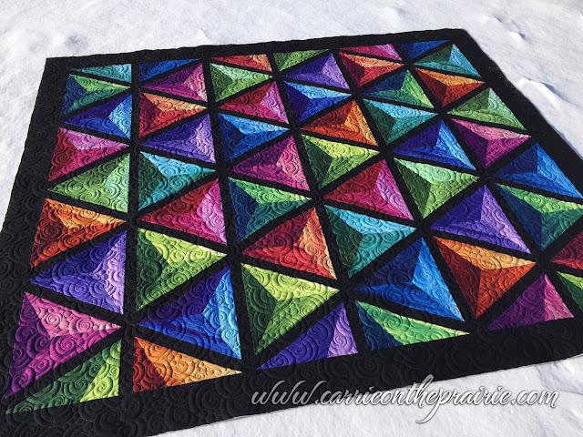 http://carrieontheprairie.blogspot.ca/2016/12/3-d-pyramid-quilt.html
