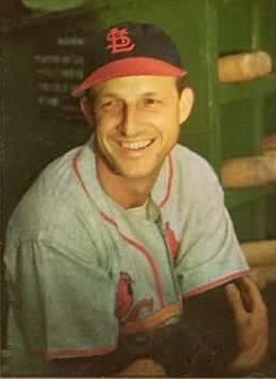 Stan Musial smiling in uniform for St. Louis