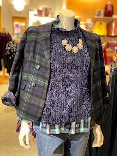 Maniquin with purple chenille sweater, plaid blazer and chunky necklace