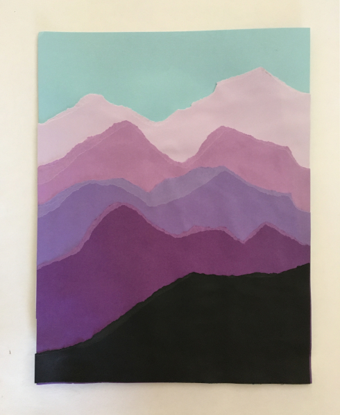 Completed torn paper mountain craft, in shades of purple