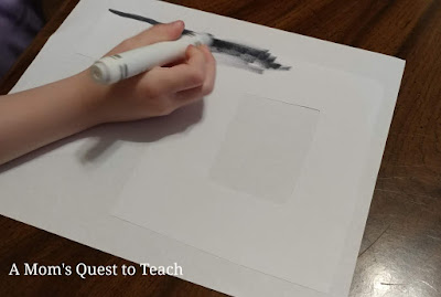 coloring the letter R with a gray marker