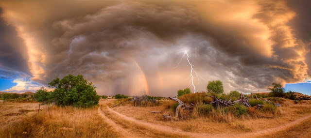 Beautiful landscape, storm, lightning and rainbow