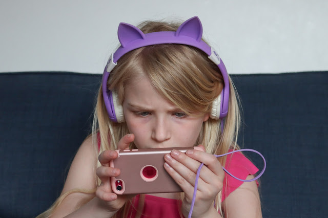 An 8 year old on her iPod touch which can be a cause of family friction and loss of temper