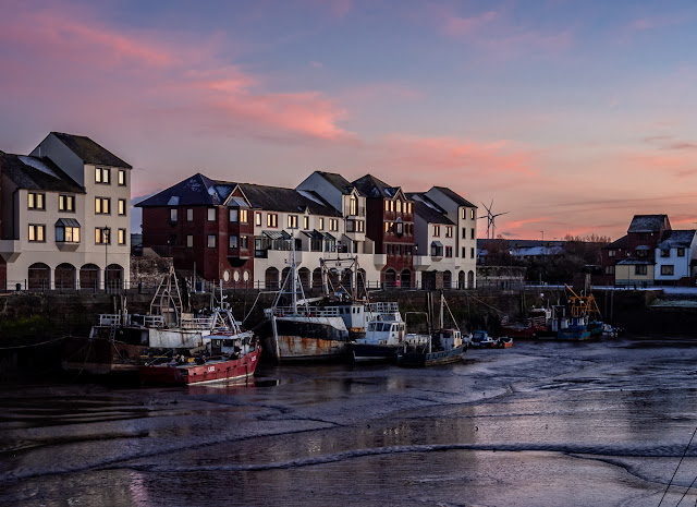 Photo of sunset at Maryport Harbour at low tide