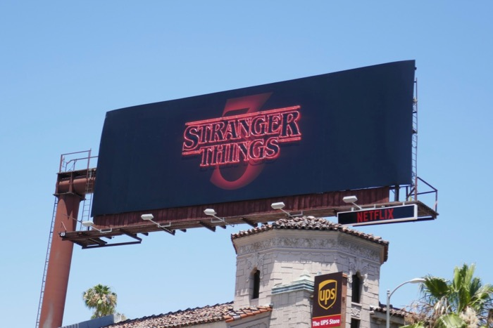 Stranger Things 3 neon sign billboard daytime