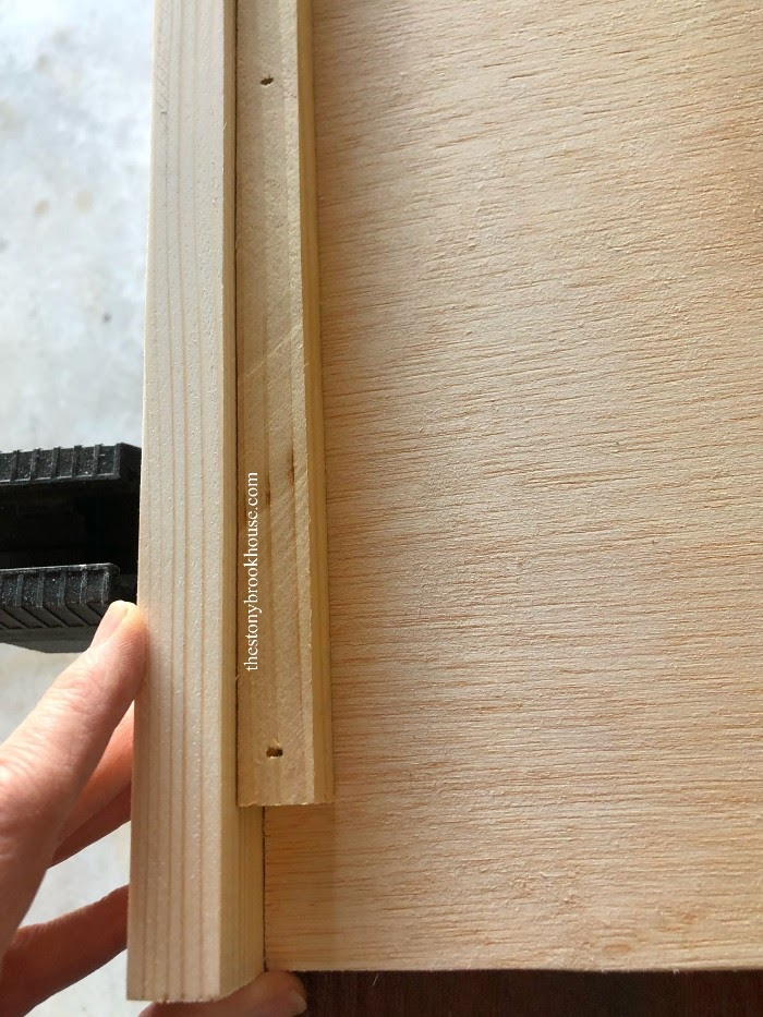 Showing how to attach front 1x2 to shelf