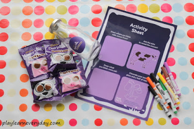 Cadburys buttons, milk bottle, worksheet and pens