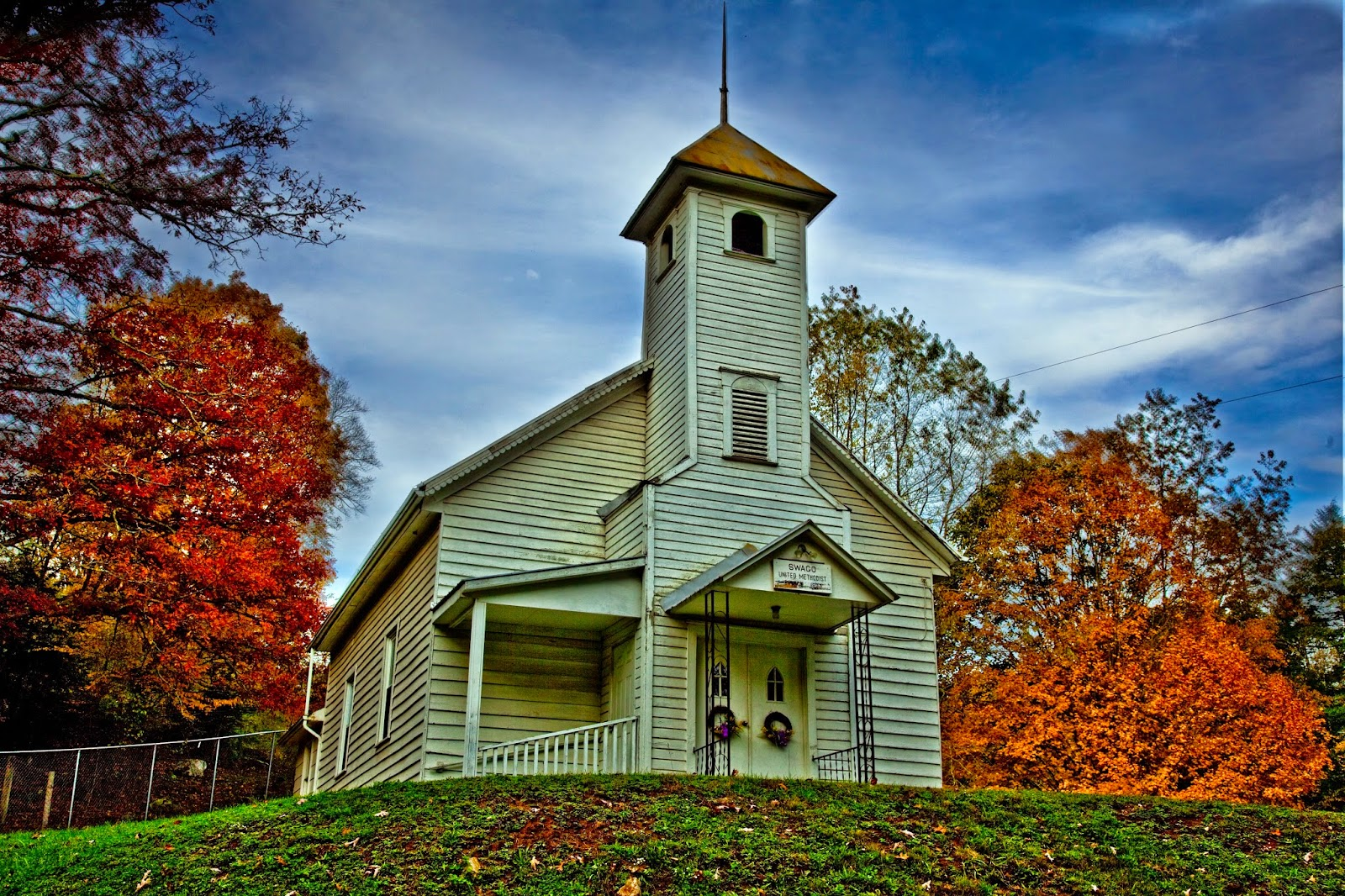 A small country church found in the mountains of West Virginia. On a clear autumn day the fall colors around this church accent the old fashioned charm of a little white church beside the road.  Picture Height: 3744 pixels Picture Width: 5616 pixels Lens Aperture: f/8 Image Exposure Time: 1/160 sec Lens Focal Length mm: 35 mm Photo Exposure Value: 0 EV Camera Model: Canon EOS 5D Mark II Photo White Balance: 0 Color Space: sRGB