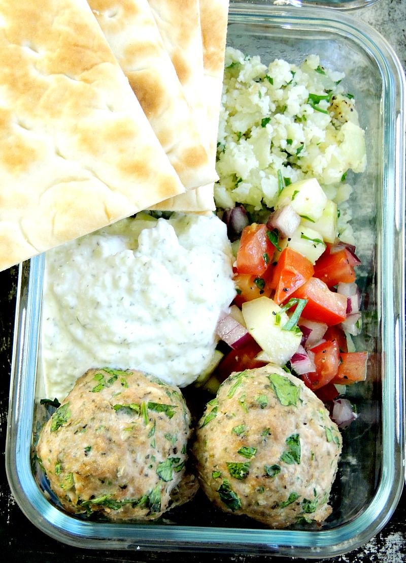 MEDITERRANEAN MEATBALLS WITH TZATZIKI OVER CAULIFLOWER RICE Make meal prep healthy and delicious with these Mediterranean Meatballs with Tzatziki Over Cauliflower Rice. #mealprep #healthy #meatballs #beef #bestangusbeef #keto #ketofriendly #cauliflowerrice #cauliflower | bobbiskozykitchen.com