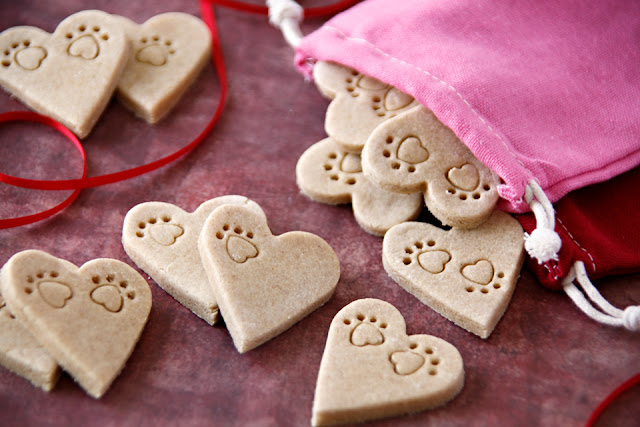Homemade dog treats with heart shaped paw prints