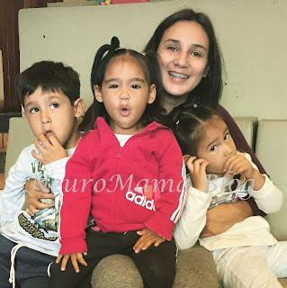 Happy mom with 3 children