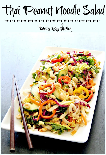 Thai Peanut Noodle Salad - Bright and beautiful, and ready in 15 minutes, this veggie packed, gluten free Thai Peanut Noodle Salad is the perfect choice for a lunch, or a meatless Monday meal. From www.bobbiskozykitchen.com