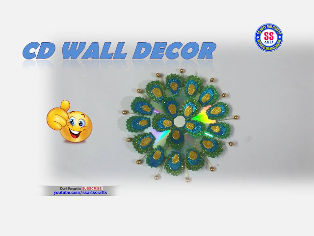 Here is recycled cd crafts,how to make wall decor using cd crafts,recycled cd crafts,how make wall decor using cd ,cd fish craft,recycle cd pencil stand,cd stratch painting,how to make cd photo frame,how to make cd flowers,how to make wall decor using old cd