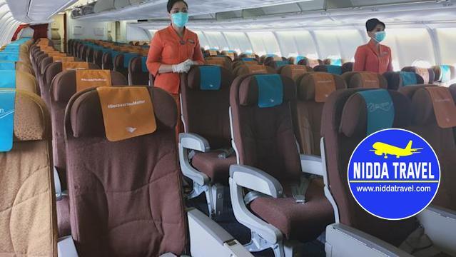 masih ada maskapai yang melanggar aturan jaga jarak di pesawat