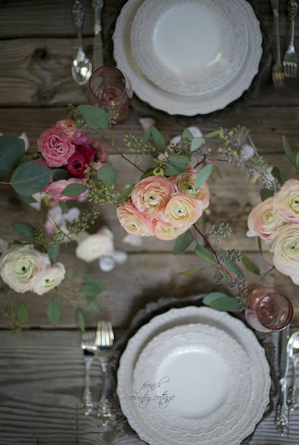 Flowers and lace dishes on table