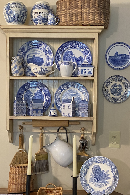 hanging shelf with blue and white transferware