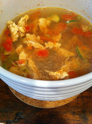Chicken and vegetable soup with carrot broth