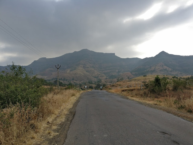 roads with golden mountain on the horizon