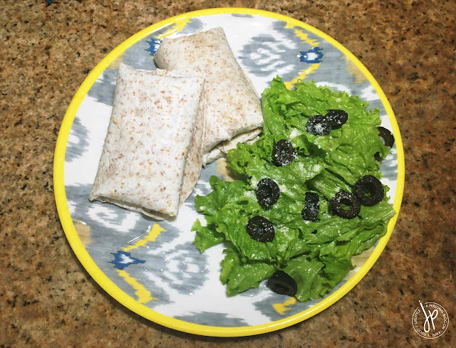 Tuna Pocket Wraps with lettuce and olives on the side