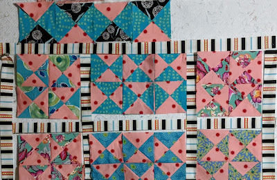 Hourglass blocks alternate blocks with pink or black outside to create a zig zag pattern.