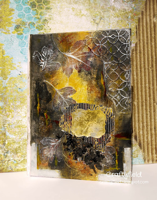 Mixed Media with paint, metal and leaves