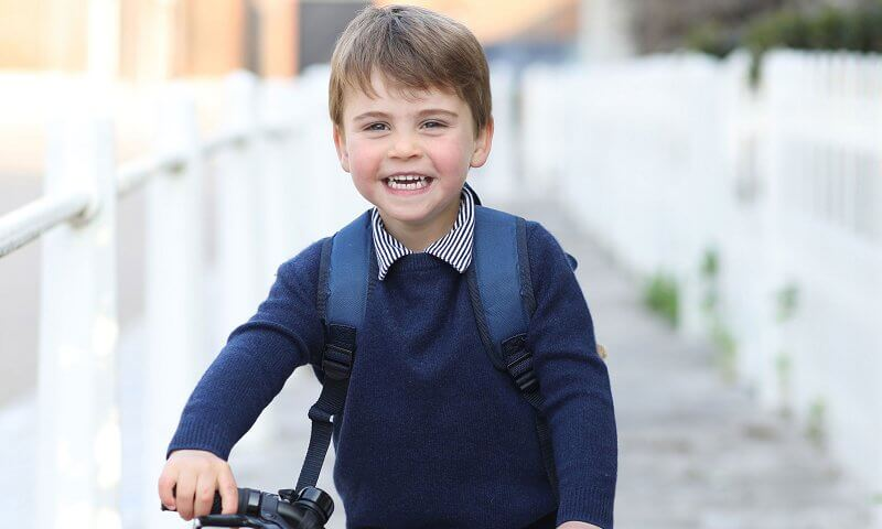 Prince Louis wore a navy jumper and shorts. Red Frog Tadpole balance bike. Princess Charlotte and Kate Middleton