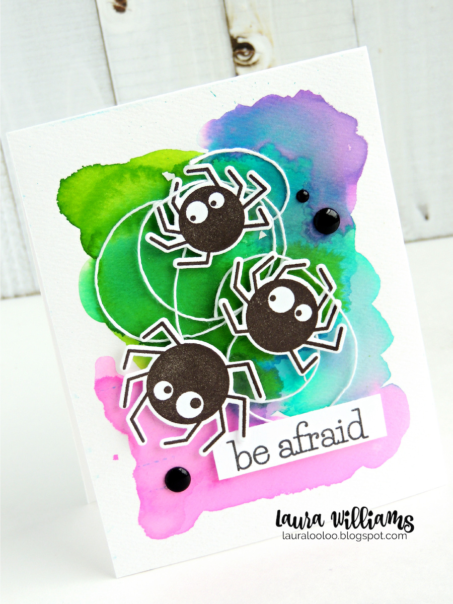 Here's another watercolored Halloween card. This one was loose and messy and fun to create. I started with liquid dye inks, and added them along with water to a sheet of watercolor paper. I let them layer together, mix and blend to create a crazy colorful background. Then I added a little twine - I mean spider webs, and added the absolutely adorable Spider Trio stamps. Those legs look tricky to cut? Not a problem because they have a coordinating die!