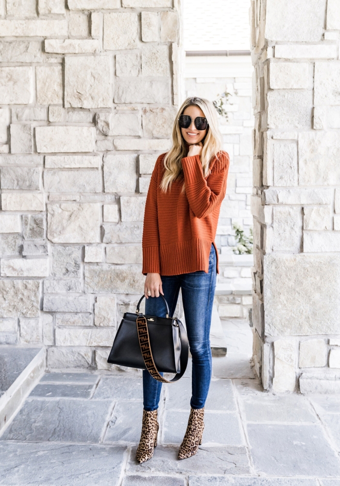 fall outfit leopard boots orange sweater skinny jeans celine sunglasses