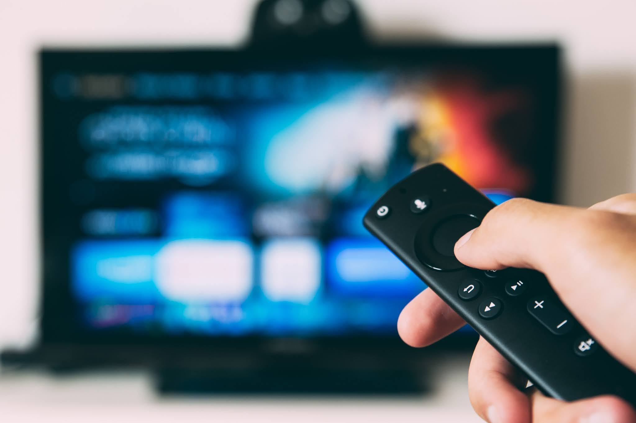 Stock image from Unsplash showing a remote and a blurred smart TV in the background