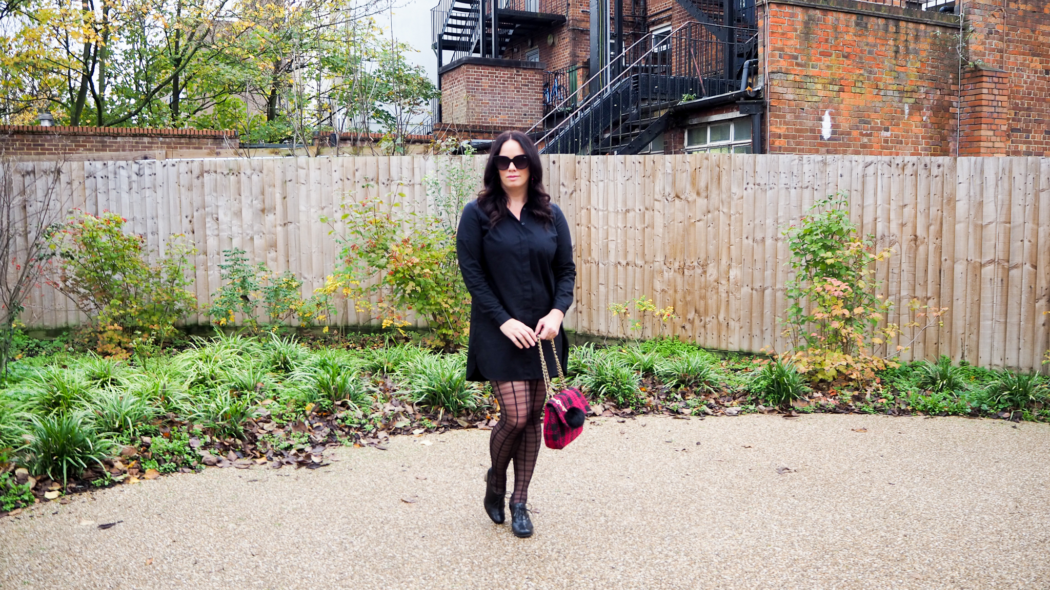 Black cotton Asos shirt dress with hot pink & black tweed bag and checked tights