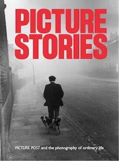 Picture Stories poster - b/w period photo of man in a flat cap walking away with dog looking at camera