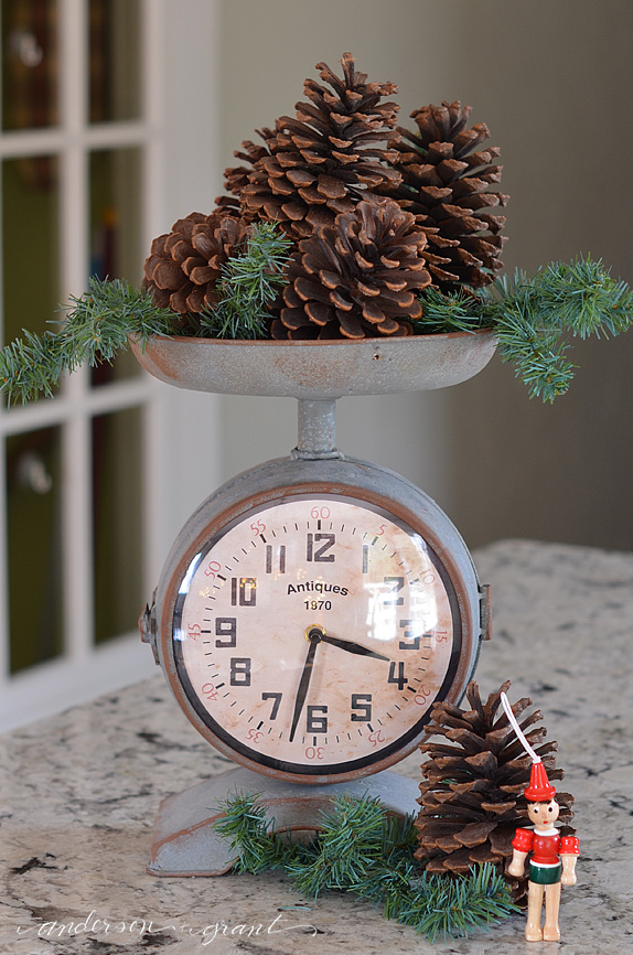 Kitchen scale filled with pinecones....easy Christmas decorating! | www.andersonandgrant.com