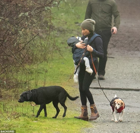 Meghan Markle threatens lawsuit over photos of her and baby Archie taken while they were hiking in Canada