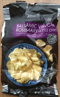 An open bag of Specially Selected Balsamic Vinegar and Rosemary Kettle Chips, from Aldi