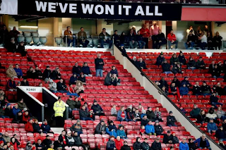 Man Utd fans leave Old Trafford at half time after derby humiliation