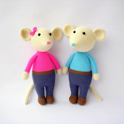 Girl and boy amigurumi mouse in clothes standing next to each other