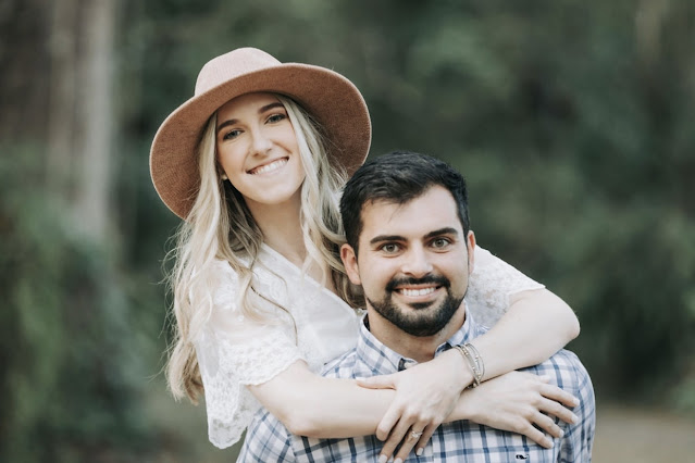 couple smiling for engagement pictures